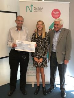 Presenting a cheque to Richard Easton, CEO of the Neurological Foundation to give back from Getagrip sales